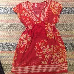 Floral bright red dress with beautiful pattern.